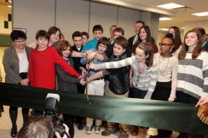 Students, faculty and guests cut the ribbon to officially open the new campus of Green Woods Charter School on Domino La. (Photo/Alison Dunlap, ADVENT)